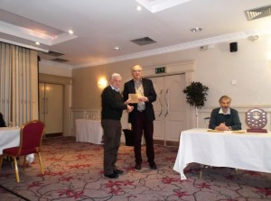Paddy Divilly, joint first winner of the Majors section, receiving his prize from Galway Chess Club treasurer Andrew.